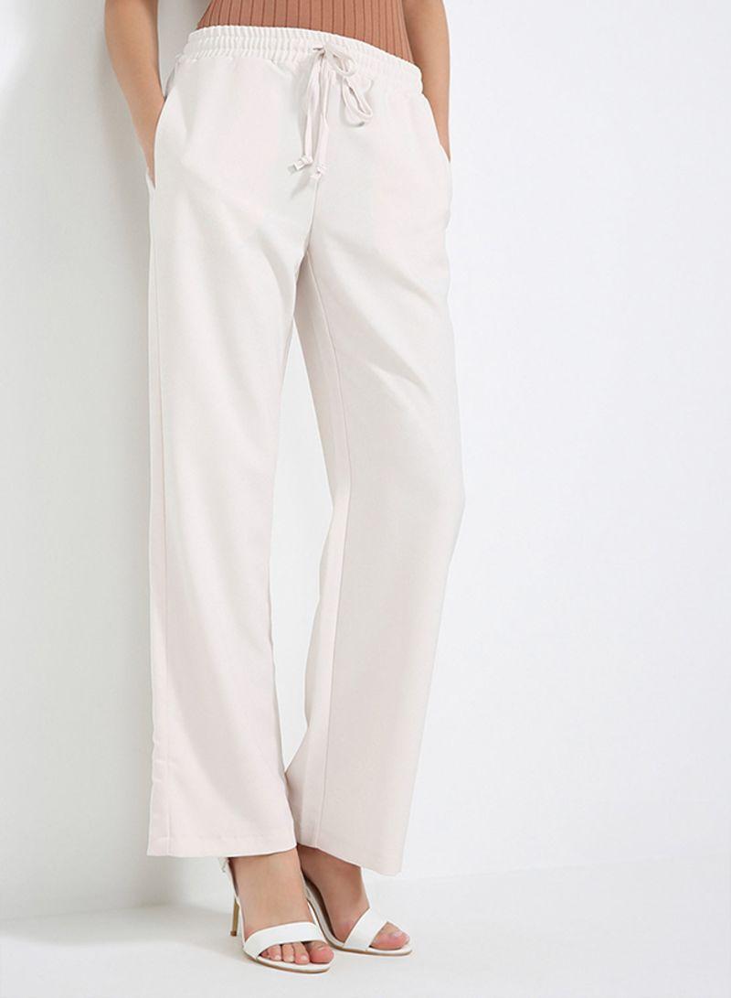 6445848d9401a سعر سراويل بتصميم كاجوال واسعة الساق أبيض فاتح فى السعودية