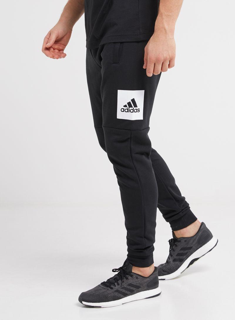 4e055fb83ba7d Shop adidas Essentials Box Logo Pants Black/White online in Riyadh ...